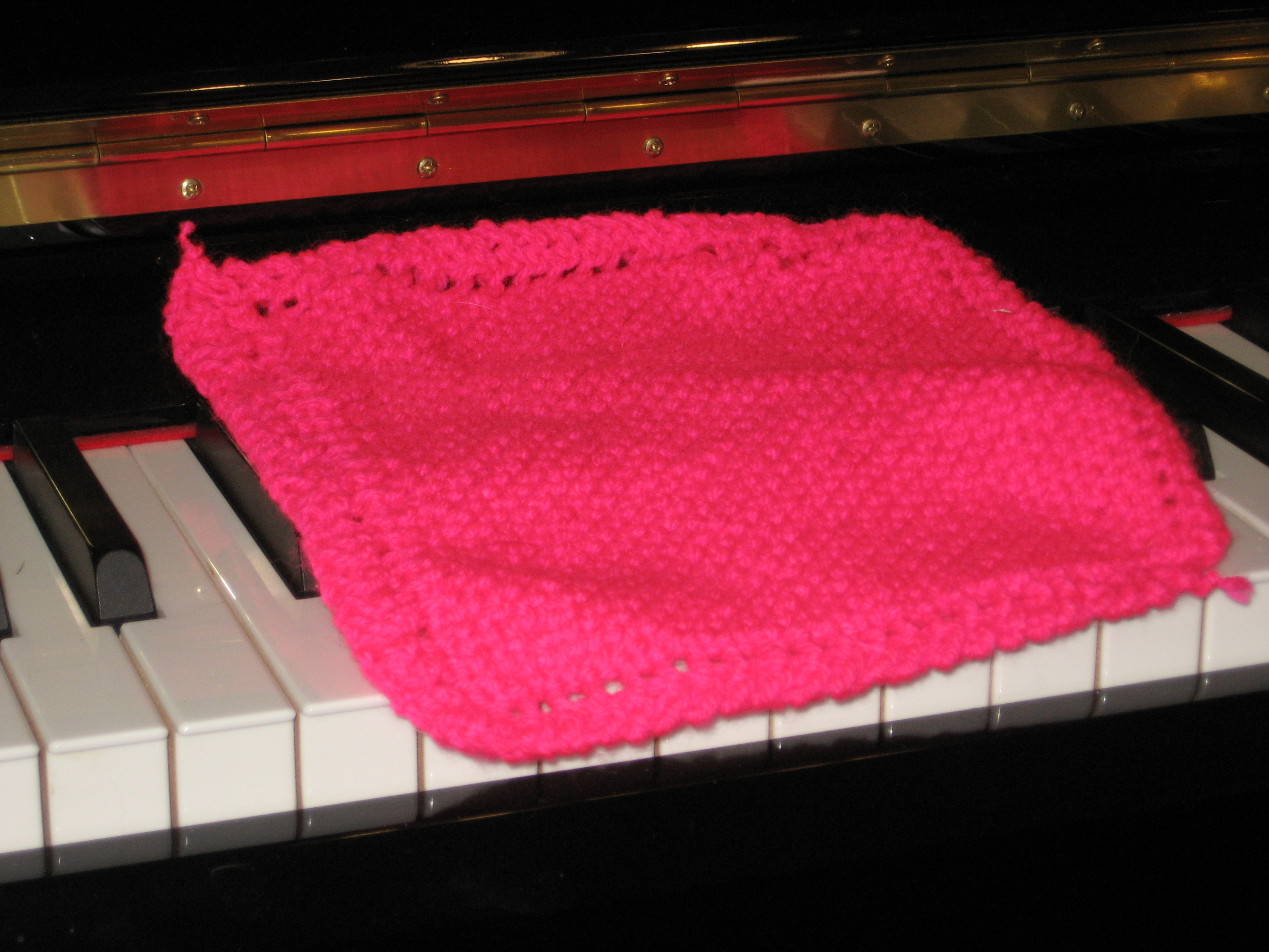 pink hand-knitted washcloth (click to buy on Etsy)